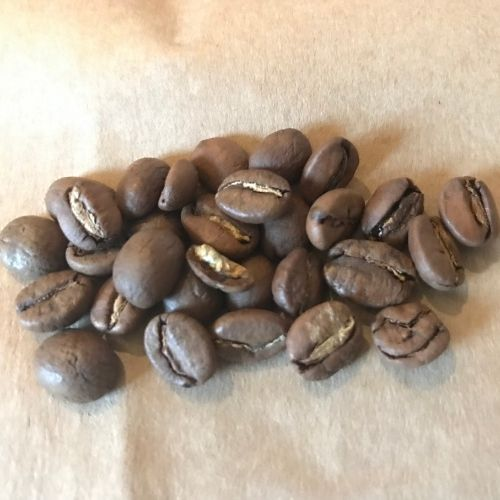 Dry coffee beans in a pile